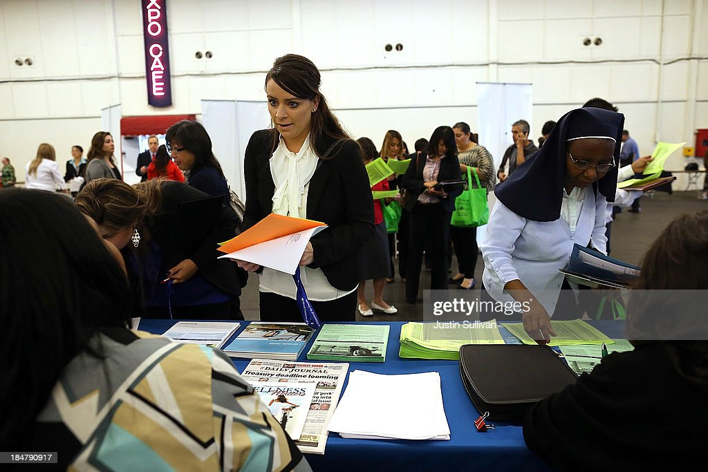 Job seekers meet with recruiters during the Job Hunters Boot Camp at the San Mateo Event Center on October 16 2013 in San Mateo California Hundreds...