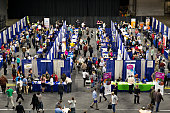 Job seekers meet with recruiters during the Quad Cities career fair in Moline Illinois US on Wednesday Oct 14 2015 The US Department of Labor is...
