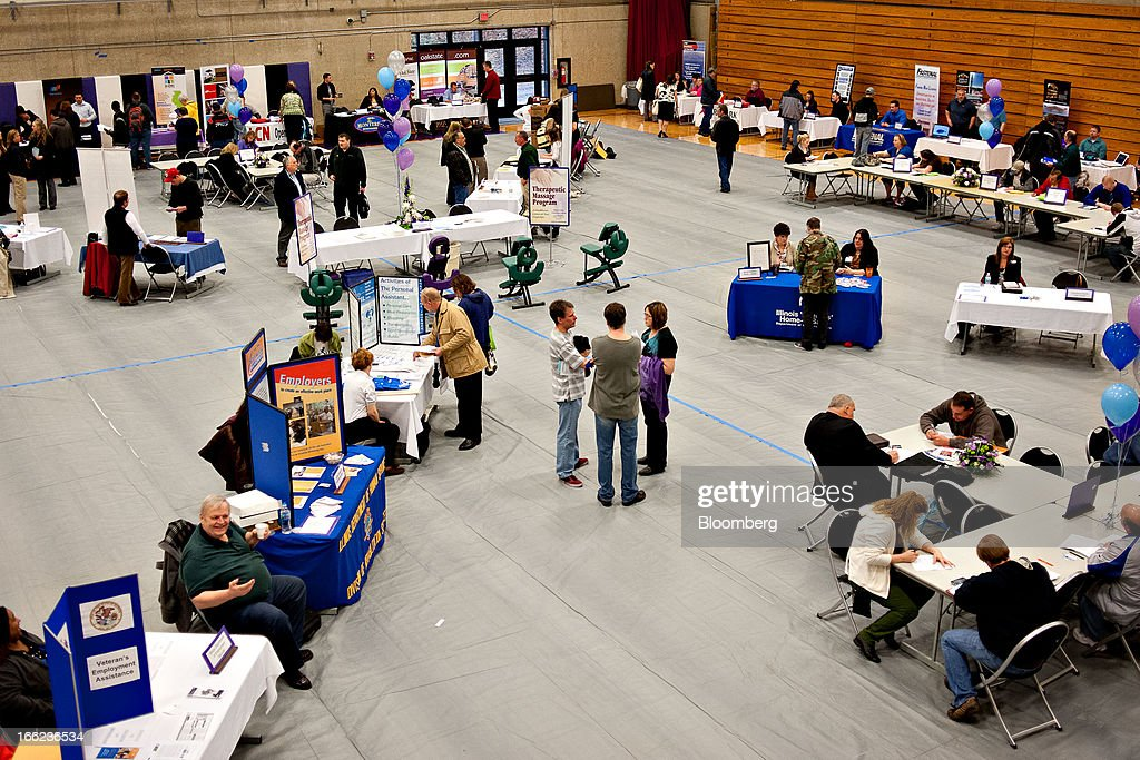 Job seekers mingle with employers during a job fair at Illinois Valley Community College (IVCC) in Oglesby, Illinois, U.S., on Wednesday, April 10, 2013. The U.S. Department of Labor is scheduled to release jobless claims figures on April 11. Photographer: Daniel Acker/Bloomberg via Getty Images