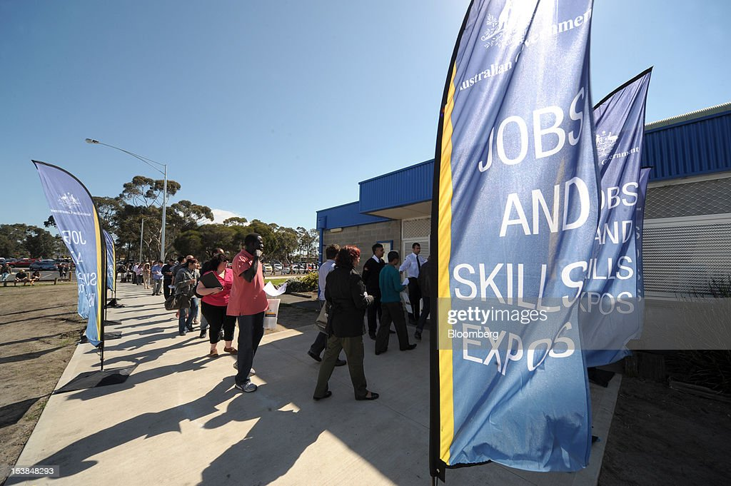 Job seekers queue to enter a jobs and skills expo run by the Australian government in Melbourne, Australia, on Thursday, Oct. 4, 2012. Australia's unemployment rate probably climbed to 5.3 percent last month from 5.1 percent in August, according to the median estimate of economists surveyed by Bloomberg News. Photographer: Carla Gottgens/Bloomberg via Getty Images