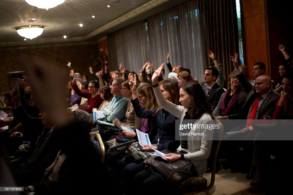 Job seekers rise their hands as they attend a conference during a Job fair organized by the Inmigration Office of Quebec in Paris and the Catalonia Employment Service (SOC) on November 29, 2012 in Barcelona, Spain.Over 40 companies from Quebec are offering more than 1000 jobs at two career fairs being held in Barcelona and Paris. Approximately 1300 job seekers attended today's fair in Barcelona after the unemployment rate in Spain increased to 25.02 percent in the third quarter of 2012, the highest in the EU.