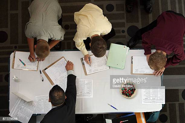 Job seekers sign in to attend the Greater Los Angeles Career Expo at the Pasadena Convention Center on May 14 2009 in Pasadena California 19...