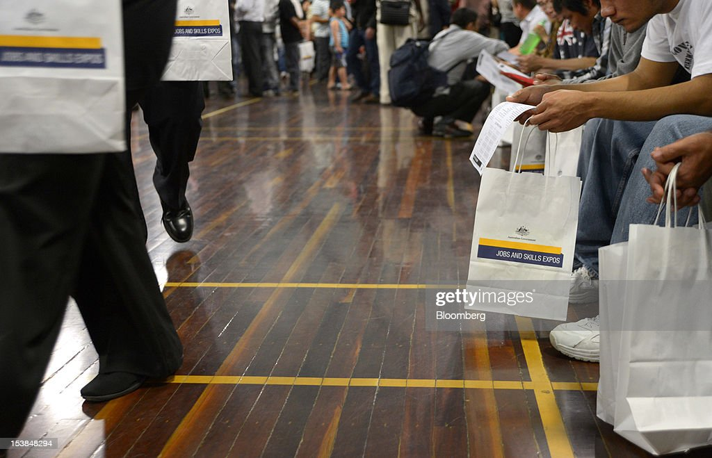 Job seekers sit as they read forms and pamphlets at a jobs and skills expo run by the Australian government in Melbourne, Australia, on Thursday, Oct. 4, 2012. Australia's unemployment rate probably climbed to 5.3 percent last month from 5.1 percent in August, according to the median estimate of economists surveyed by Bloomberg News. Photographer: Carla Gottgens/Bloomberg via Getty Images