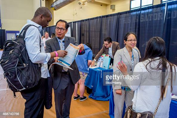 Job seekers speak with recruiters during a career fair at San Francisco State University in San Francisco California US on Friday April 3 2015...