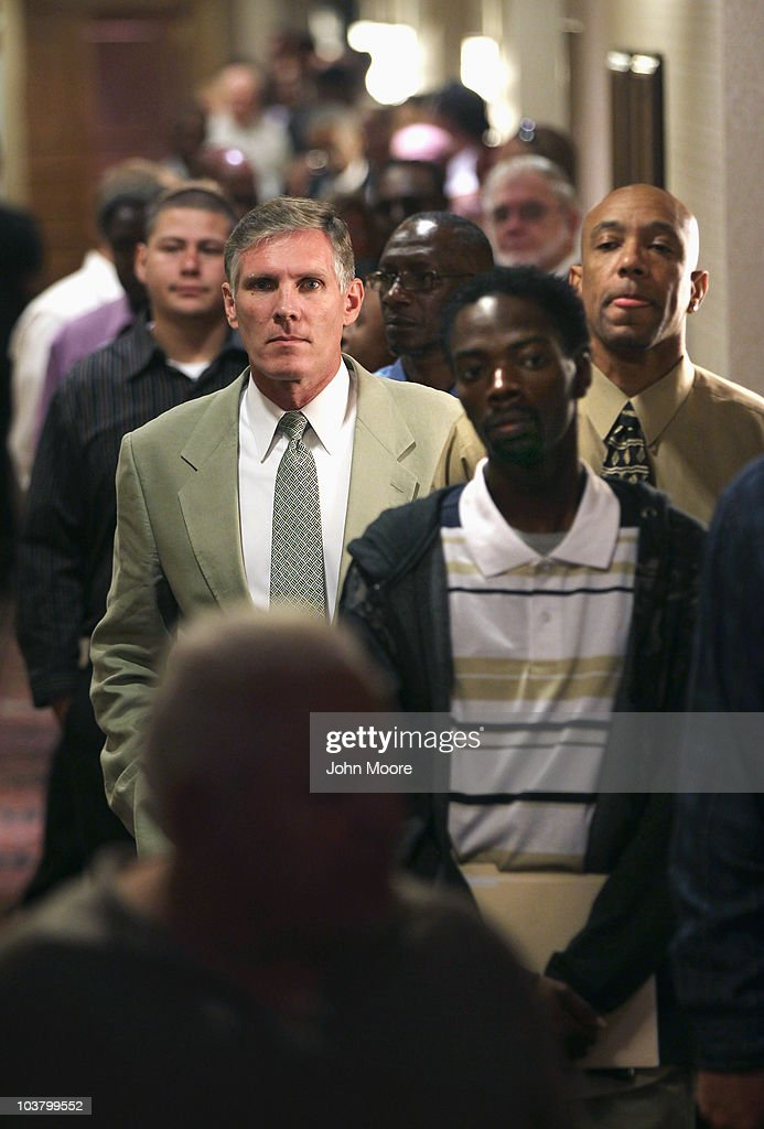 Job seekers stand and wait for a career fair to open on September 2, 2010 in Denver, Colorado. Hundreds of unemployed and underemployed Coloradans turned out for the event. The federal government will announce its monthly national unemployment figures on Friday.