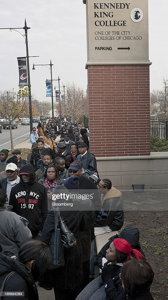 Job seekers stand in line at the City of Chicago job fair at Kennedy King College in Chicago, Illinois, U.S., on Friday, Nov. 9, 2012. The U.S. Department of Labor is scheduled to release initial jobless claims data on Nov. 15. Photographer: Frank Polich/Bloomberg via Getty Images