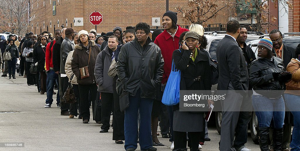 Job seekers stand in line to enter the City of Chicago job fair at Kennedy King College in Chicago, Illinois, U.S., on Friday, Nov. 9, 2012. The U.S. Department of Labor is scheduled to release initial jobless claims data on Nov. 15. Photographer: Frank Polich/Bloomberg via Getty Images