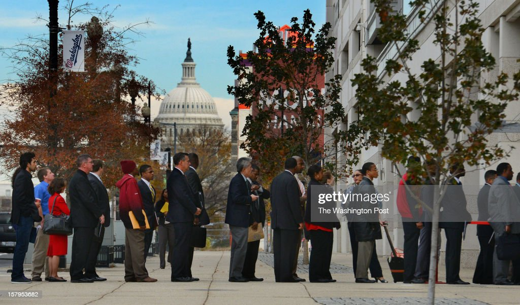 Job seekers stand in line to sign-in before entering a job fair for the military, held by the Washington Nationals and the U.S. Chamber of Commerce's National Chamber Foundation, on December 5, 2012 in Washington, DC. Eighty seven employers and 407 job seekers, including retired military, active duty and verterans, attened the job fair at the Stars and Stripes Club at National's Park. The event is the 379th hiring fair by Hiring Our Heros job and is sponsored by the U.S. Chamber of Commerce, the Washington Nationals and the Military Bowl.
