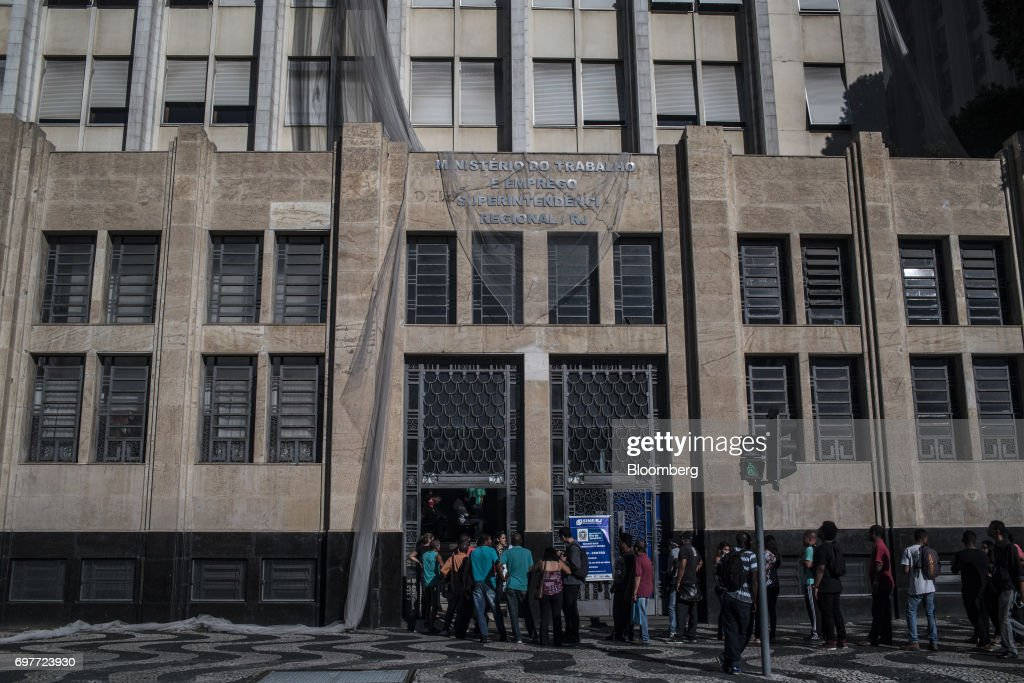 Job seekers stand on line outside the Ministry of Labor and Employment building in Rio de Janeiro, Brazil, on Monday, June 19, 2017. The Brazil Labor Ministry is scheduled to release government registered job creation figures on June 20. Photographer: Dado Galdieri/Bloomberg via Getty Images