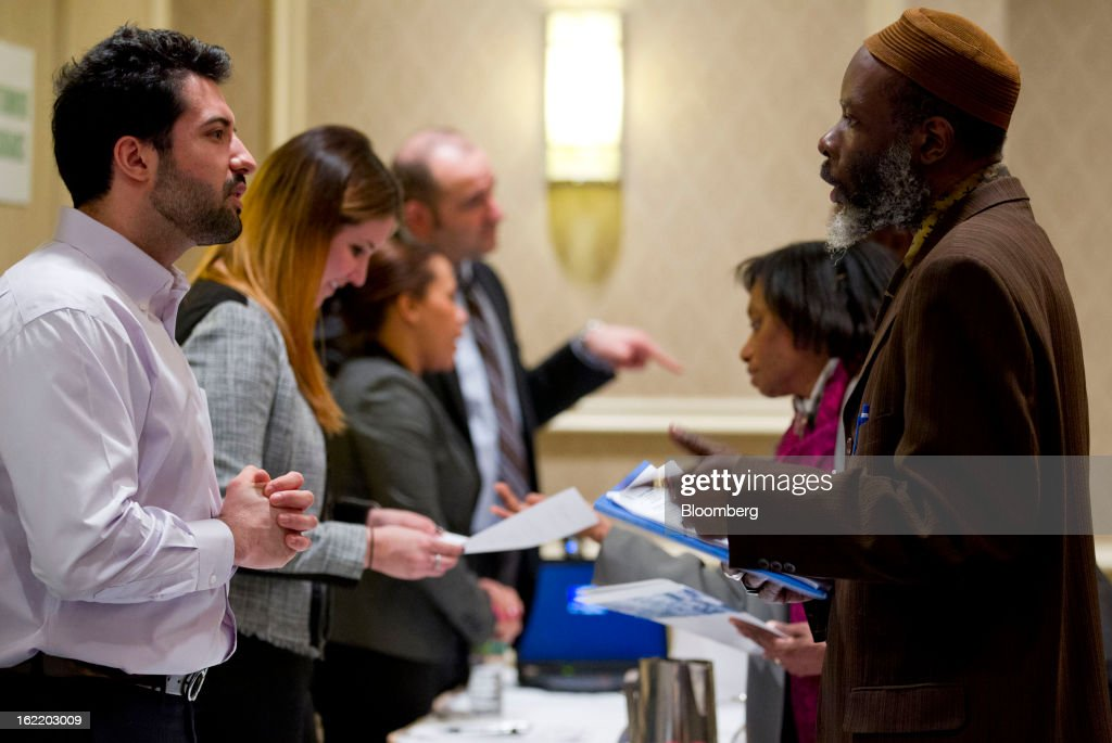 Job seekers talk to recruiters at a job fair organized by United Career Fairs in New York, U.S., on Tuesday, Feb. 19, 2013. The U.S. Labor Department is scheduled to release initial jobless claims figures on Feb. 21. Photographer: Jin Lee/Bloomberg via Getty Images