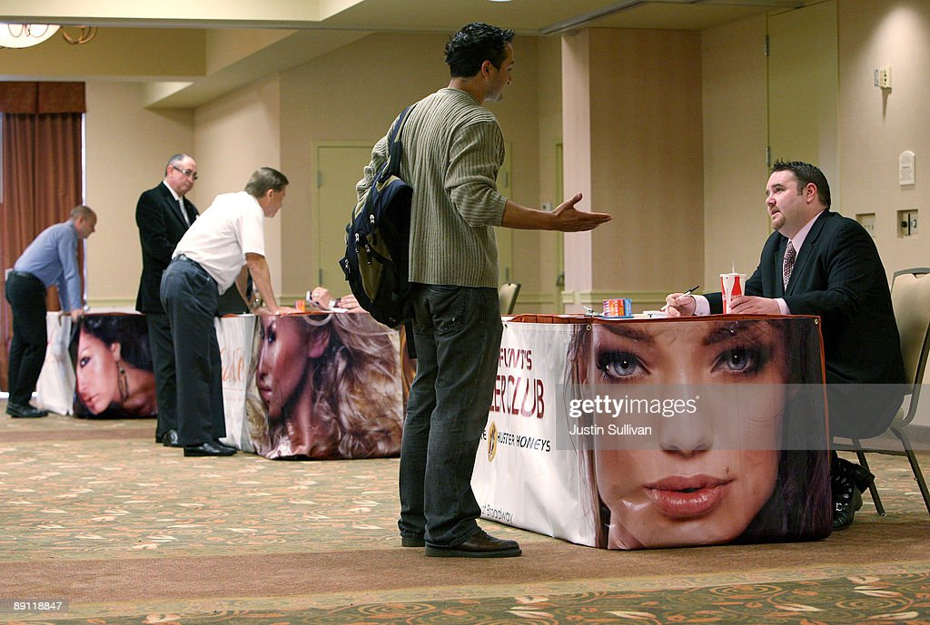 Job seekers talk with potential employers during a job fair for the adult entertainment industry July 20, 2009 in San Francisco, California. Hundreds of job seekers attended a job fair that featured eleven San Francisco strip clubs offering jobs ranging from bartender and cashiers to exotic dancers and waitresses.