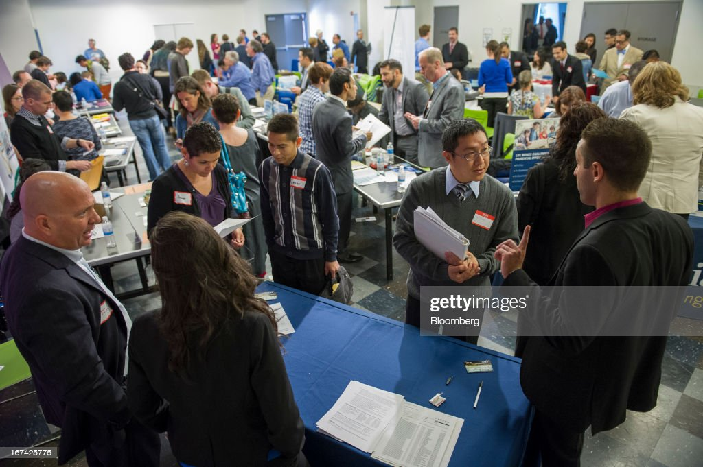 Job seekers talk with recruiters at the Spring LGBT Career Fair in San Francisco, California, U.S., on Wednesday, April 24, 2013. Fewer Americans than forecast filed first-time claims for unemployment insurance payments last week, pointing to an improving labor market. Photographer: David Paul Morris/Bloomberg via Getty Images
