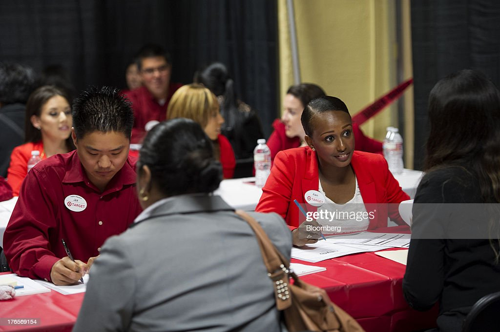 Job seekers talk with Target Corp. employees during a hiring event at a new store in San Francisco, California, U.S., on Thursday, Aug. 15, 2013. Claims for jobless benefits unexpectedly dropped by 15,000 to 320,000 in the week ended Aug. 10, the fewest since October 2007. Photographer: David Paul Morris/Bloomberg via Getty Images