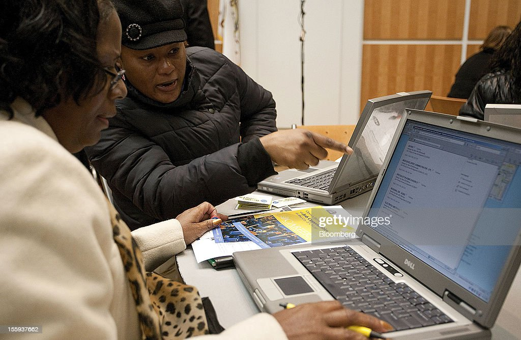 Job seekers use laptop computers to apply for jobs at the City of Chicago job fair at Kennedy King College in Chicago, Illinois, U.S., on Friday, Nov. 9, 2012. The U.S. Department of Labor is scheduled to release initial jobless claims data on Nov. 15. Photographer: Frank Polich/Bloomberg via Getty Images