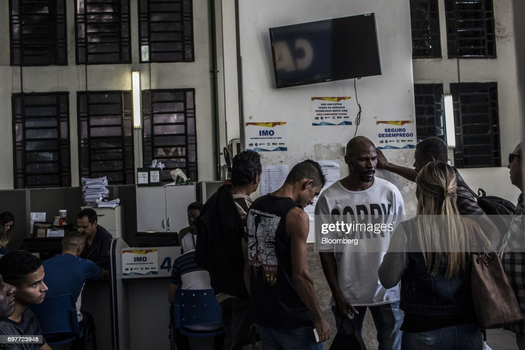 Job seekers view job announcements displayed inside the Ministry of Labor and Employment building in Rio de Janeiro, Brazil, on Monday, June 19, 2017. The Brazil Labor Ministry is scheduled to release government registered job creation figures on June 20. Photographer: Dado Galdieri/Bloomberg via Getty Images