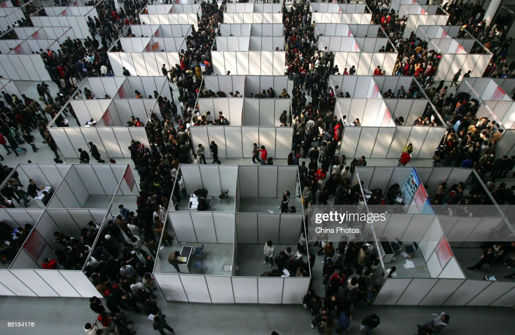 Job seekers visit a job fair for graduating university students at the Qujiang International Convention and Exhibition Center on February 28, 2009 in Xian of Shaanxi Province, China. China is facing a difficult employment situation in 2009 as the global financial crisis impacts on the country's economy. According to the Ministry of Human Resources and Social Security, China's urban registered unemployment rate climbed to 4.2 percent in December 2008, its highest level in 5 years, with an estimated 20 million migrant workers reported to have lost their jobs due to the shutdown of factories which produce goods for export.