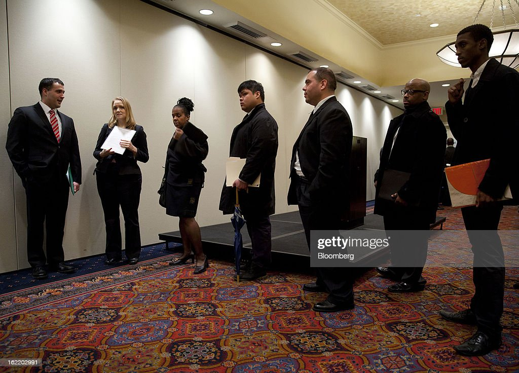 Job seekers wait in a line to see recruiters at a job fair organized by United Career Fairs in New York, U.S., on Tuesday, Feb. 19, 2013. The U.S. Labor Department is scheduled to release initial jobless claims figures on Feb. 21. Photographer: Jin Lee/Bloomberg via Getty Images