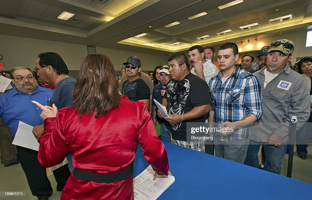 Job seekers wait in line at a job application event for TPCO America Corp. in Portland, Texas, U.S., on Friday, Nov. 9, 2012. TPCO America Corp., a subsidiary of The Tianjin Pipe Group Corp., is a maker of seamless steel pipe used primarily in the energy industry. The U.S. Department of Labor is scheduled to release initial jobless claims data on Nov. 15. Photographer: Eddie Seal/Bloomberg via Getty Images