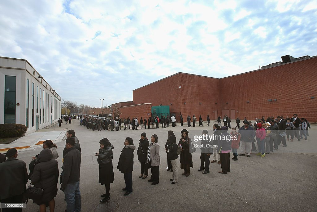 Job seekers wait in line at Kennedy-King College to attend a job fair hosted by the city of Chicago on November 9, 2012 in Chicago, Illinois. Thousands of people started to line up at 3AM for the job fair which did not begin until 9AM. When the doors opened the line was about a half-mile long.