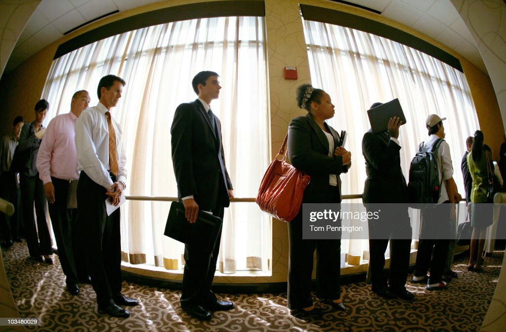 Job seekers wait in line at the Choice Career Fair held at the Doubletree Hotel on August 19, 2010 in Dallas, Texas. First-time jobless claims rose for the third week in a row, reaching the highest level in nine months.