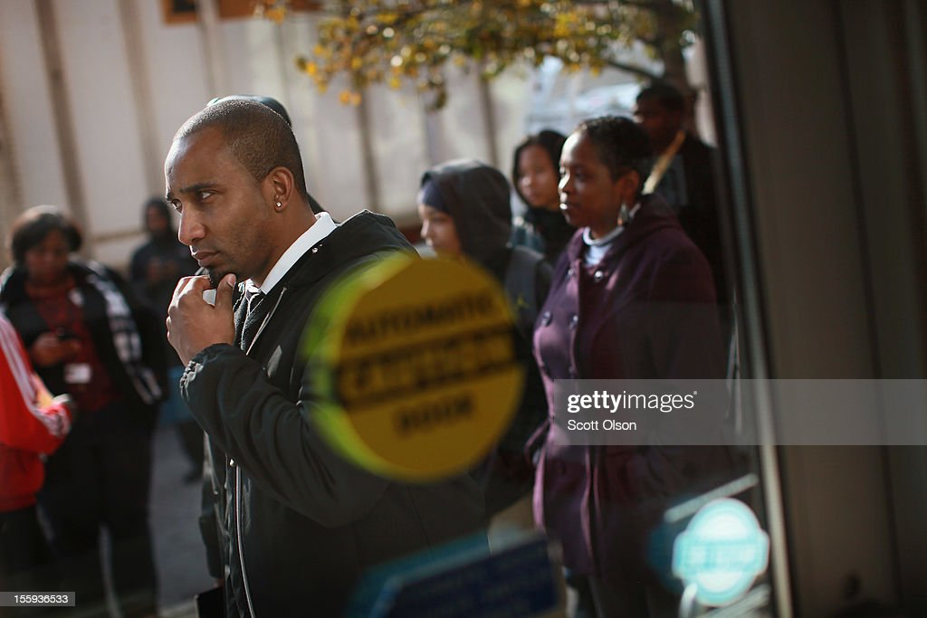 Job seekers wait in line outside Kennedy-King College to attend a job fair hosted by the city of Chicago on November 9, 2012 in Chicago, Illinois. Thousands of people waited in line beginning at 3AM for the job fair which did not open the doors until 9AM. When the doors opened the line was approximately a half-mile long.