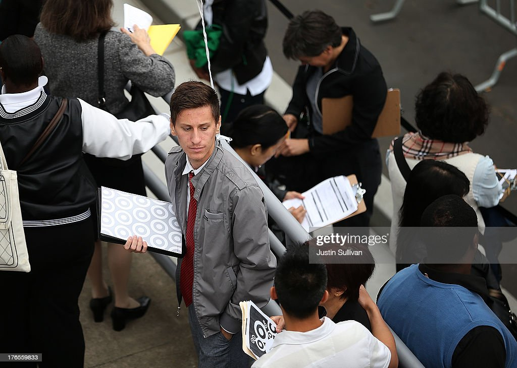 Job seekers wait in line to enter a job fair at a new Target retail store on August 15, 2013 in San Francisco, California. Hundreds of job seekers applied for jobs during a job fair to staff a new Target City store. According to a report by the Labor Department, the number of people seeking first time unemployment benefits fell to the lowest level since 2007 with initial jobless claims decreasing by 15,000 to 320,000.
