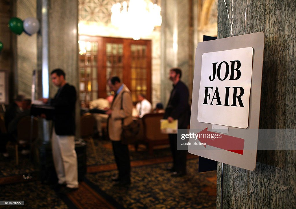 Job seekers wait in line to enter the San Francisco Hire Event job fair on November 9, 2011 in San Francisco, California. The national unemployment rate dipped this past month to 9 percent in October after employers added 80,000 jobs.