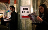 Job seekers wait in line to enter the San Francisco Hirevent job fair at the Hotel Whitmore on July 12 2011 in San Francisco California As the...