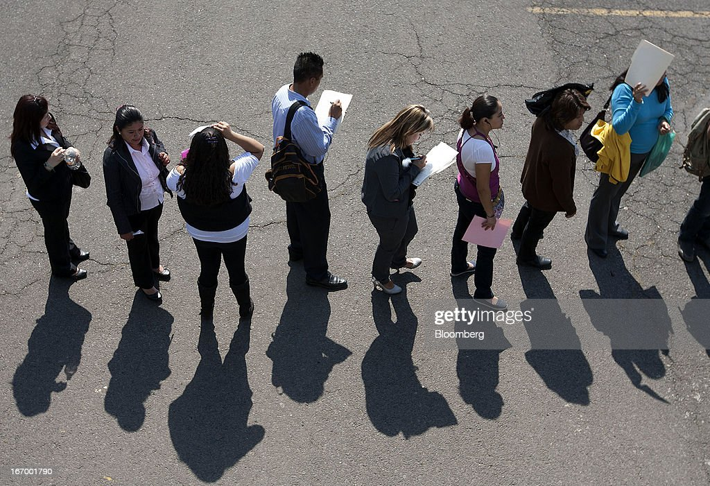 Job seekers wait in line to enter the XXVII job fair at the Palacio de los Deportes in Mexico City, Mexico, on Thursday, April 18, 2013. Mexico created 53,994 permanent and temporary urban jobs in March, according to reports from the Mexican Social Security Institute (IMSS). Photographer: Susana Gonzalez/Bloomberg via Getty Images