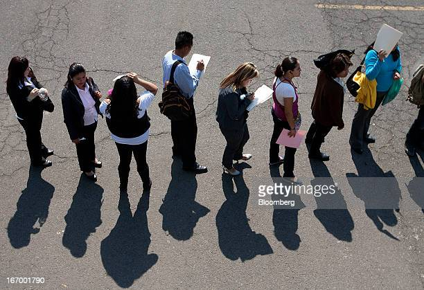 Job seekers wait in line to enter the XXVII job fair at the Palacio de los Deportes in Mexico City Mexico on Thursday April 18 2013 Mexico created...