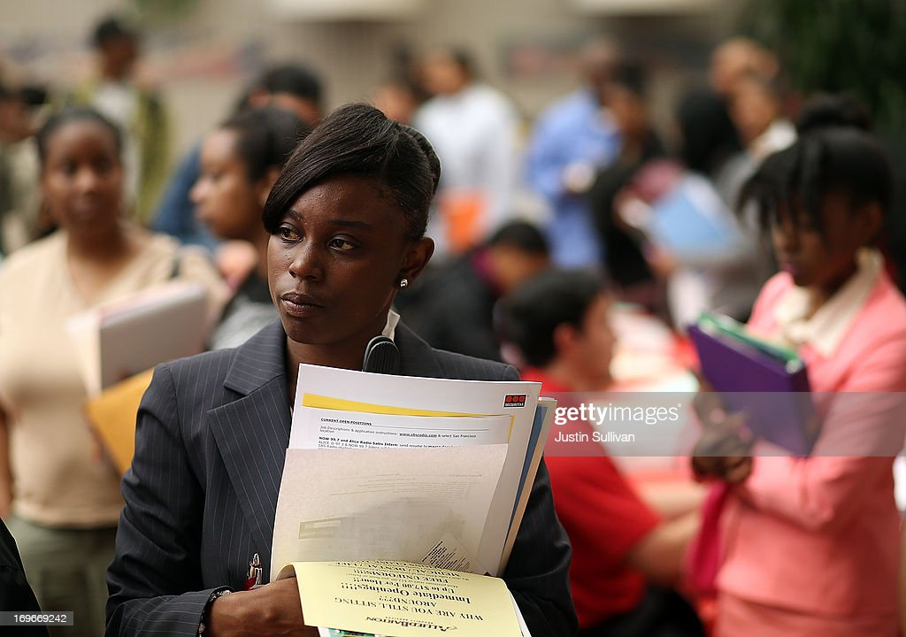 Job seekers wait in line to meet with a recruiter during a job and career fair at City College of San Francisco southeast campus on May 30, 2013 in San Francisco, California. Hundreds of job seekers attended a career fair hosted by the San Francisco Southeast Community Facility Commission.