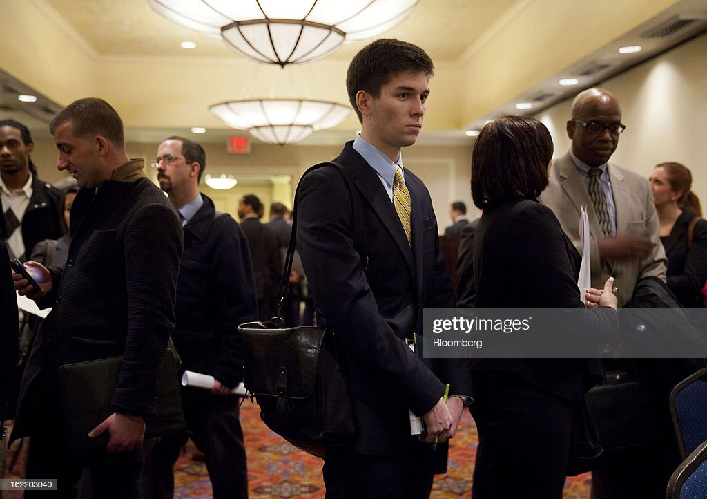 Job seekers wait in line to see recruiters at a job fair organized by United Career Fairs in New York, U.S., on Tuesday, Feb. 19, 2013. The U.S. Labor Department is scheduled to release initial jobless claims figures on Feb. 21. Photographer: Jin Lee/Bloomberg via Getty Images