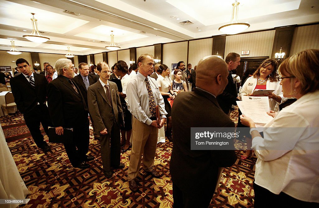 Job seekers wait in line to talk with recruiters during the Choice Career Fair held at the Doubletree Hotel on August 19, 2010 in Dallas, Texas. First-time jobless claims rose for the third week in a row, reaching the highest level in nine months.