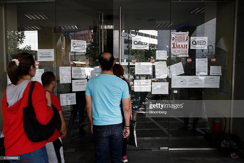 Job seekers wait to enter an OAED employment center in Athens, Greece ...