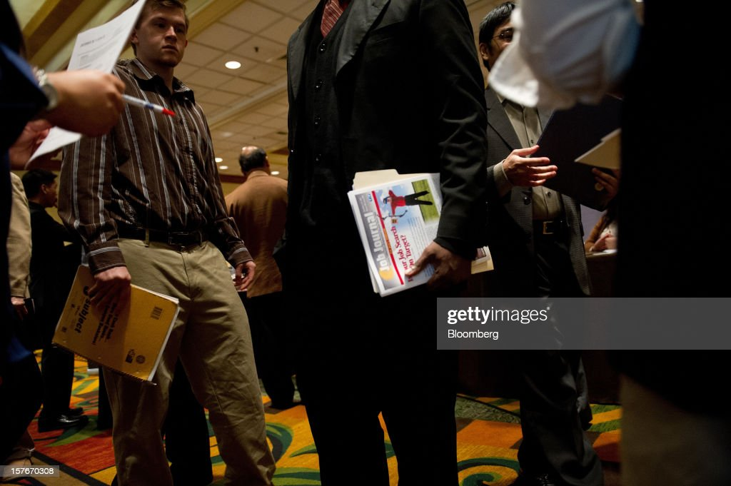 Job seekers wait to speak to a recruiter during a HIREvent job fair in San Jose, California, U.S., on Tuesday, Dec. 4, 2012. The U.S. Labor Department is scheduled to release initial jobless claims data on Dec. 6. Photographer: David Paul Morris/Bloomberg via Getty Images