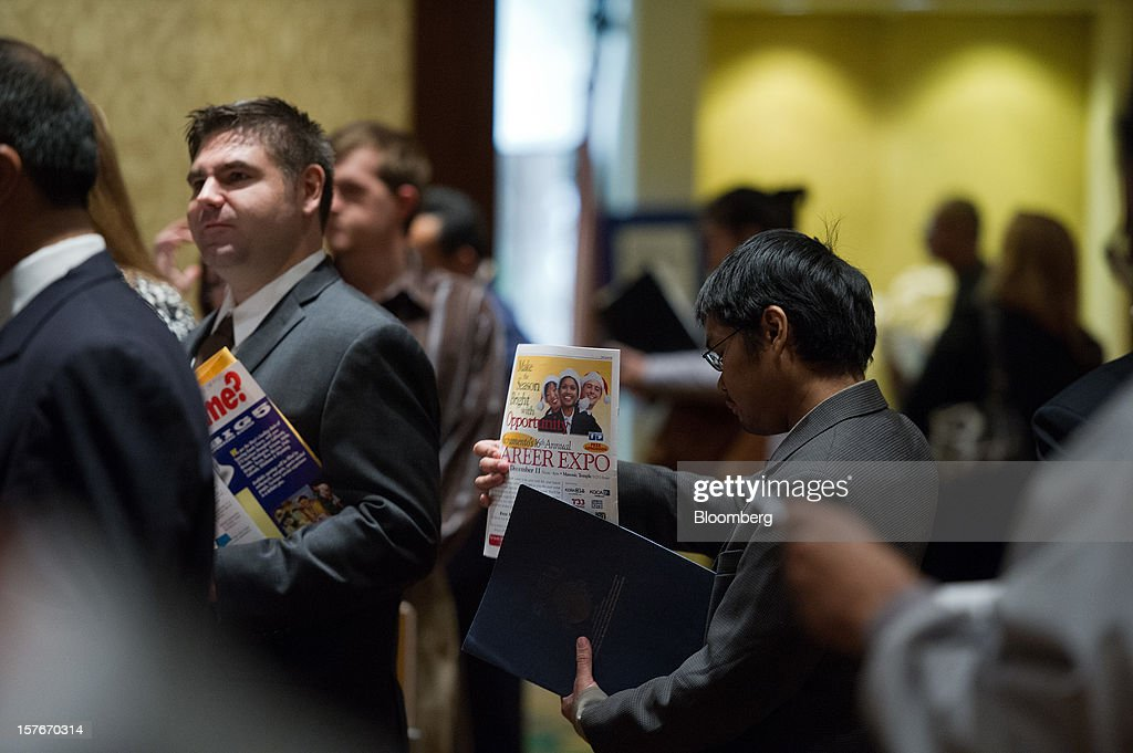 Job seekers wait to speak to recruiters during a HIREvent job fair in San Jose, California, U.S., on Tuesday, Dec. 4, 2012. The U.S. Labor Department is scheduled to release initial jobless claims data on Dec. 6. Photographer: David Paul Morris/Bloomberg via Getty Images