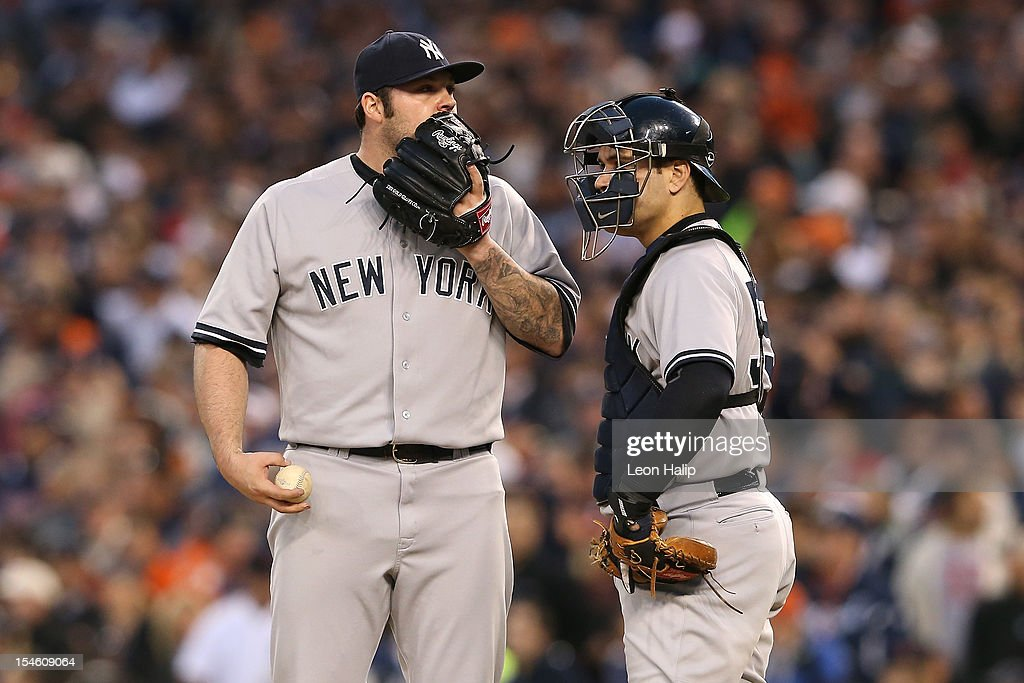Joba Chamberlain #62 and Russell Martin #55 of the New York Yankees talk on the mound against the Detroit Tigers during game four of the American League Championship Series at Comerica Park on October 18, 2012 in Detroit, Michigan.