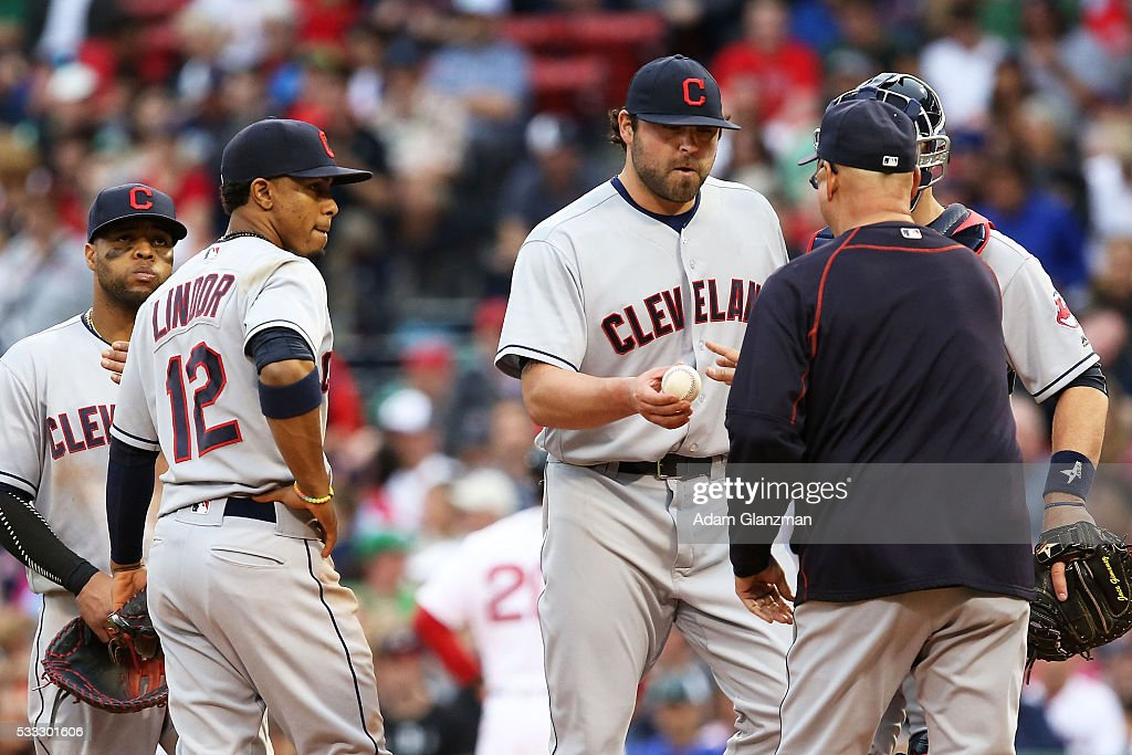 Joba Chamberlain #62 of the Cleveland Indians is taken out of the game after giving up a grand slam to Mookie Betts #50 of the Boston Red Sox in the seventh inning during the game at Fenway Park on May 21, 2016 in Boston, Massachusetts.