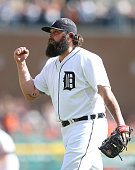 Joba Chamberlain of the Detroit Tigers celebrates the final out of the eighth inning of the game against the Minnesota Twins at Comerica Park on...