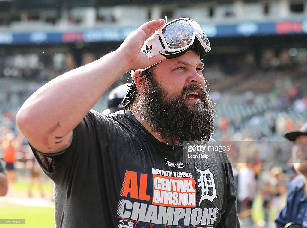 Joba Chamberlain of the Detroit Tigers celebrates with the fans a win over the Minnesota Twins and a Central Division Championship at Comerica Park...