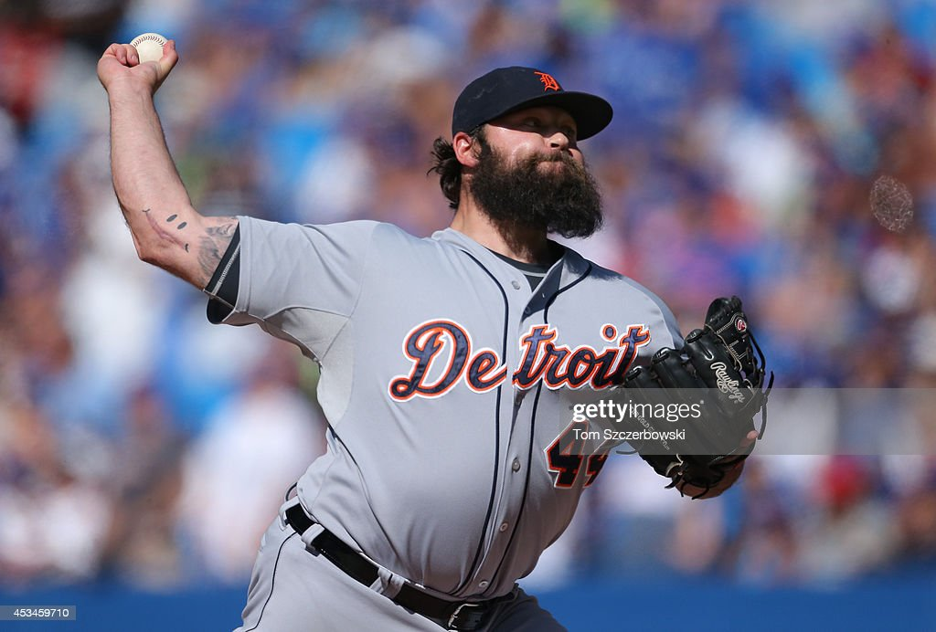 <a gi-track='captionPersonalityLinkClicked' href=/galleries/search?phrase=Joba+Chamberlain&family=editorial&specificpeople=4391682 ng-click='$event.stopPropagation()'>Joba Chamberlain</a> #44 of the Detroit Tigers delivers a pitch in the ninth inning during MLB game action against the Toronto Blue Jays on August 10, 2014 at Rogers Centre in Toronto, Ontario, Canada.