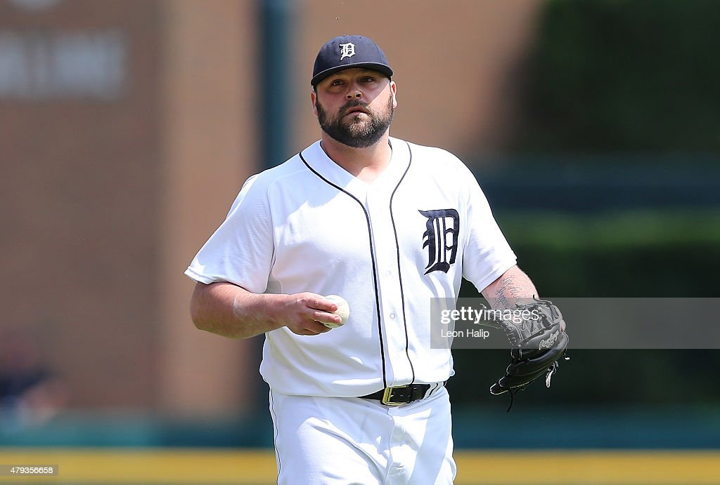 Joba Chamberlain of the Detroit Tigers looks into home plate during the eight inning of the interleague game against the Pittsburgh Pirates on July 2...