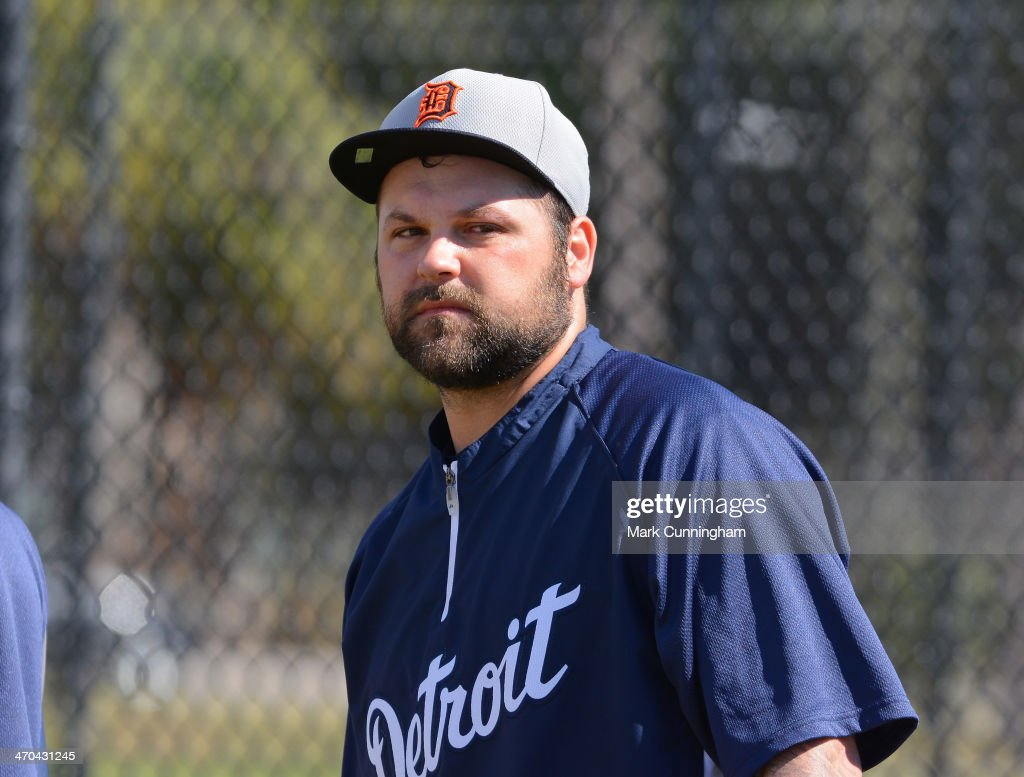 Joba Chamberlain of the Detroit Tigers looks on during the spring training workout day at the TigerTown complex on February 19 2014 in Lakeland...