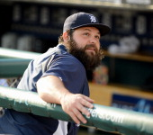 Joba Chamberlain of the Detroit Tigers looks on from the dugout prior to the game against the Tampa Bay Rays at Comerica Park on July 3 2014 in...