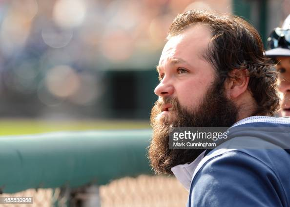 Joba Chamberlain of the Detroit Tigers looks on from the dugout during the game against the Cleveland Indians at Comerica Park on September 14 2014...
