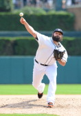 Joba Chamberlain of the Detroit Tigers pitches during the game against the Cleveland Indians at Comerica Park on July 20 2014 in Detroit Michigan The...