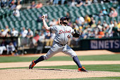Joba Chamberlain of the Detroit Tigers pitches during the game against the Oakland Athletics at Oco Coliseum on May 27 2015 in Oakland California The...