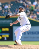 Joba Chamberlain of the Detroit Tigers pitches during the game against the Cleveland Indians at Comerica Park on April 17 2014 in Detroit Michigan...