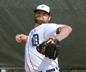 Joba Chamberlain of the Detroit Tigers pitches during the spring training workout day at the TigerTown complex on February 15 2014 in Lakeland Florida