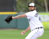 Joba Chamberlain of the Detroit Tigers pitches during the spring training game against the Pittsburgh Pirates at Joker Marchant Stadium on March 4...